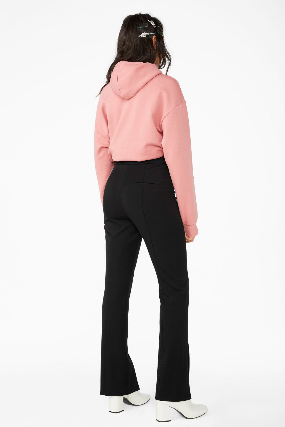 Model back image of Monki front slit trousers in black
