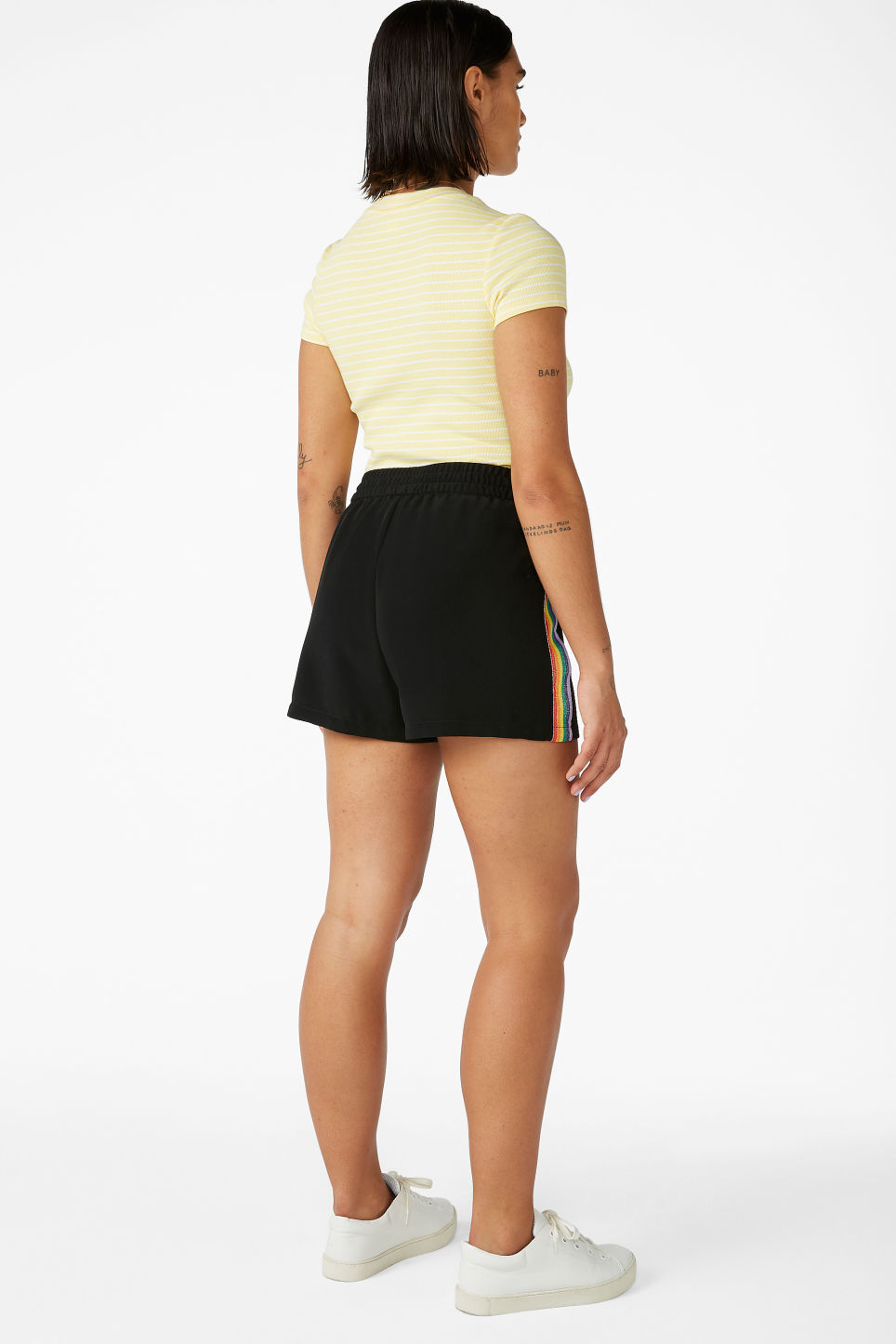 Model back image of Monki rainbow side stripe shorts in black
