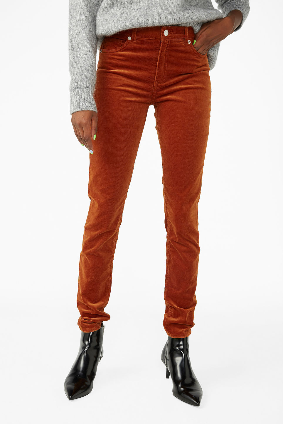 Model side image of Monki corduroy trousers in orange