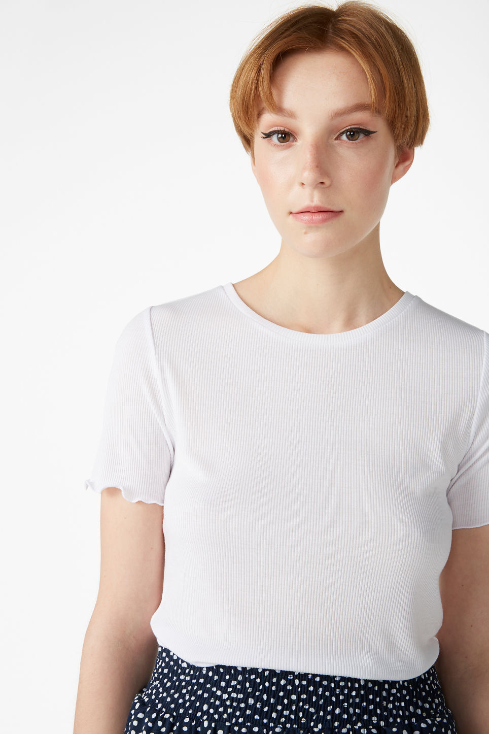 Model front image of Monki frill hem t-shirt in white