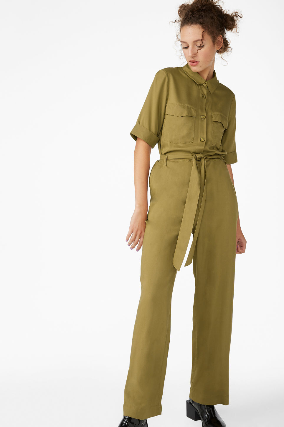 Model front image of Monki utilitarian jumpsuit in beige