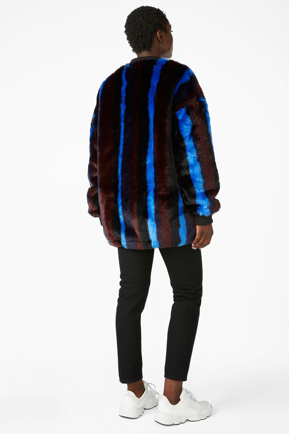 Model back image of Monki faux fur jacket in black