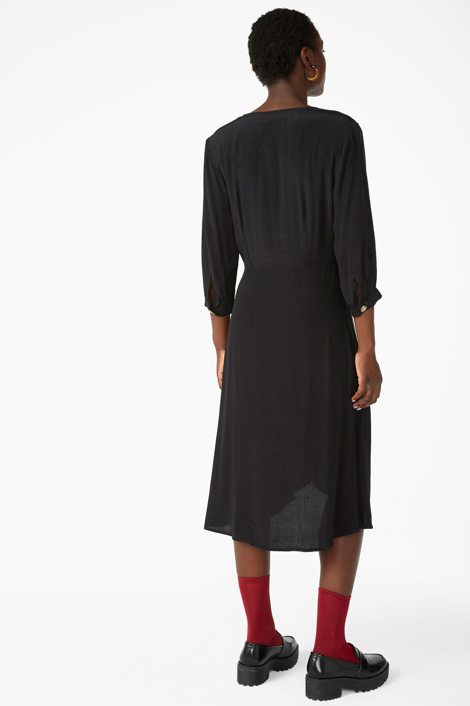 Model back image of Monki buttoned wrap dress in black