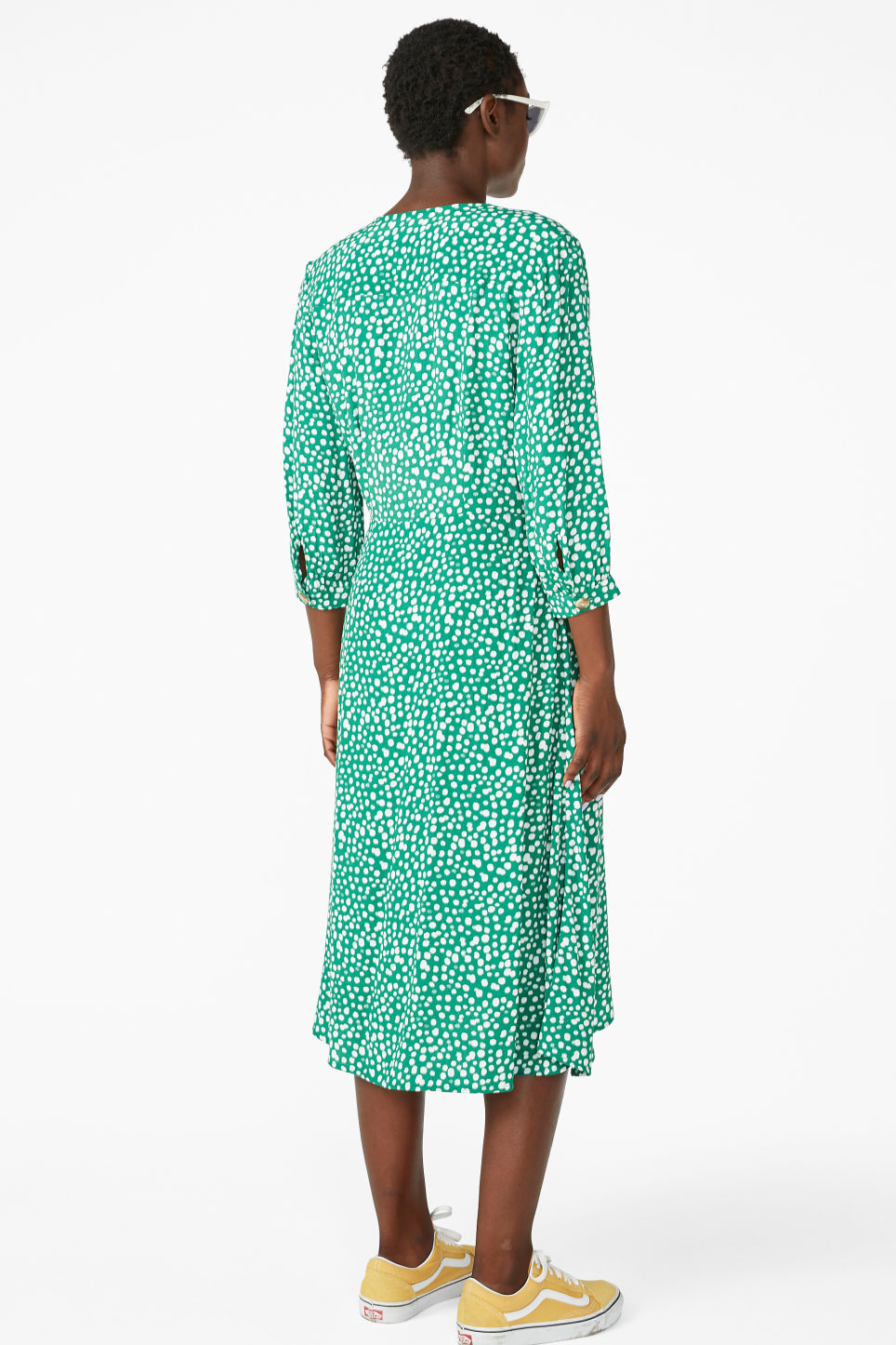 Model back image of Monki buttoned wrap dress in green