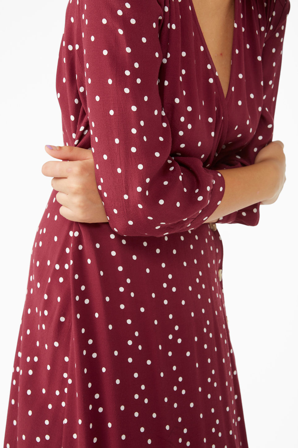 Model side image of Monki buttoned wrap dress in red