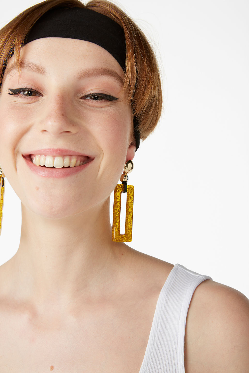 Model front image of Monki glitter statements earrings in brown