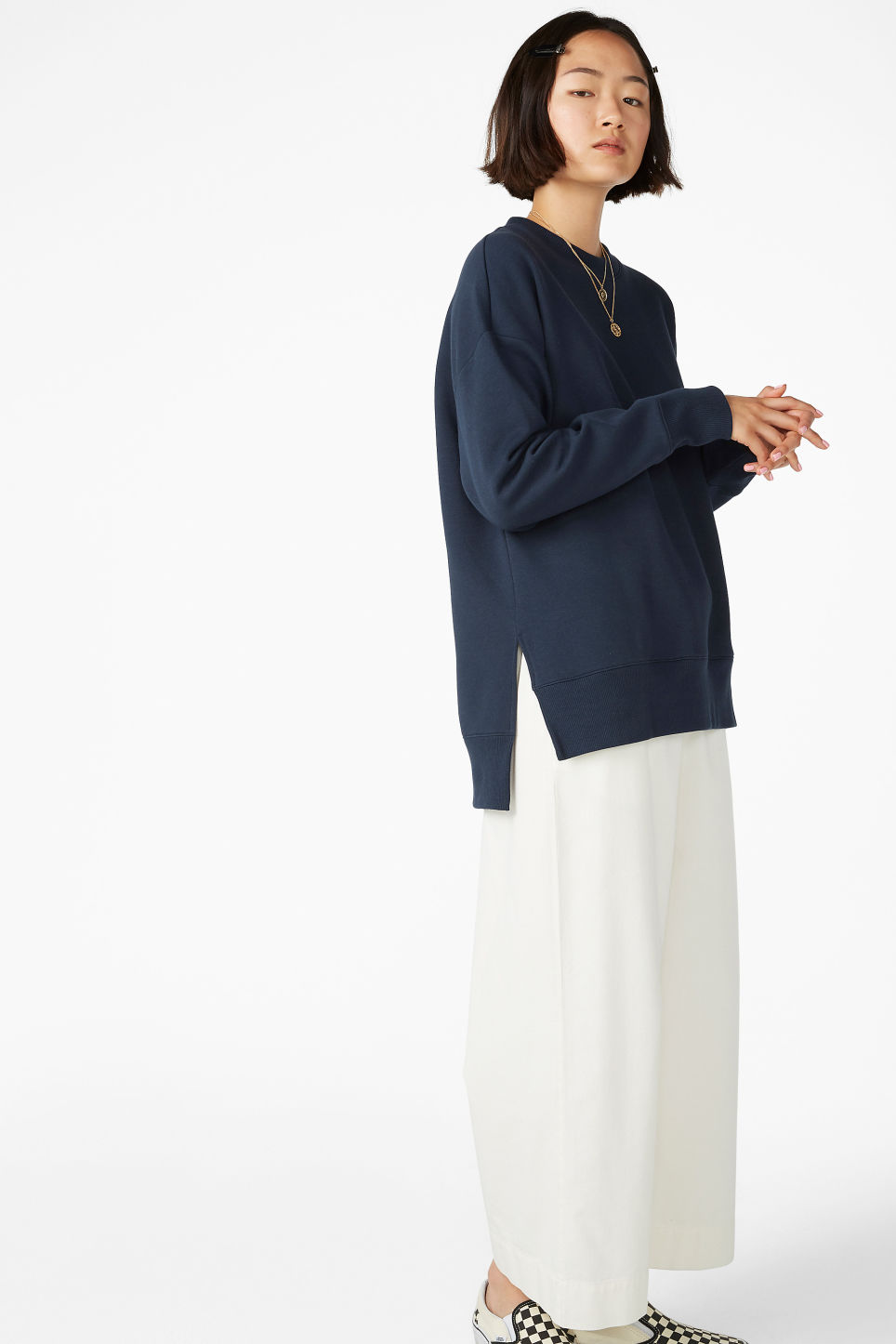 Model side image of Monki asymmetrical sweatshirt  in blue