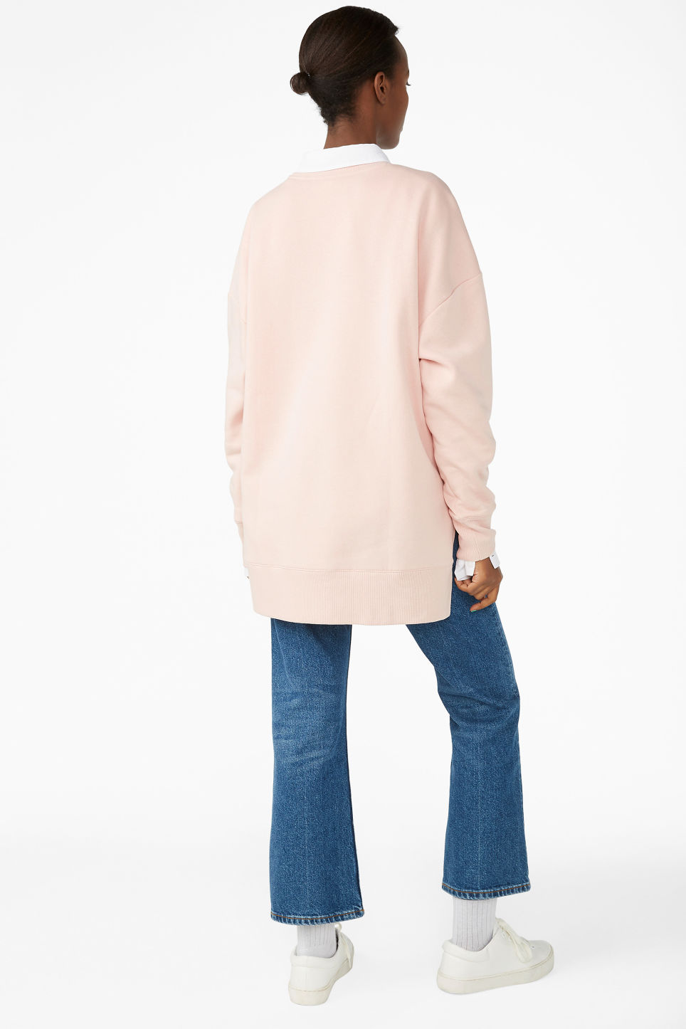 Model back image of Monki asymmetrical sweatshirt  in pink