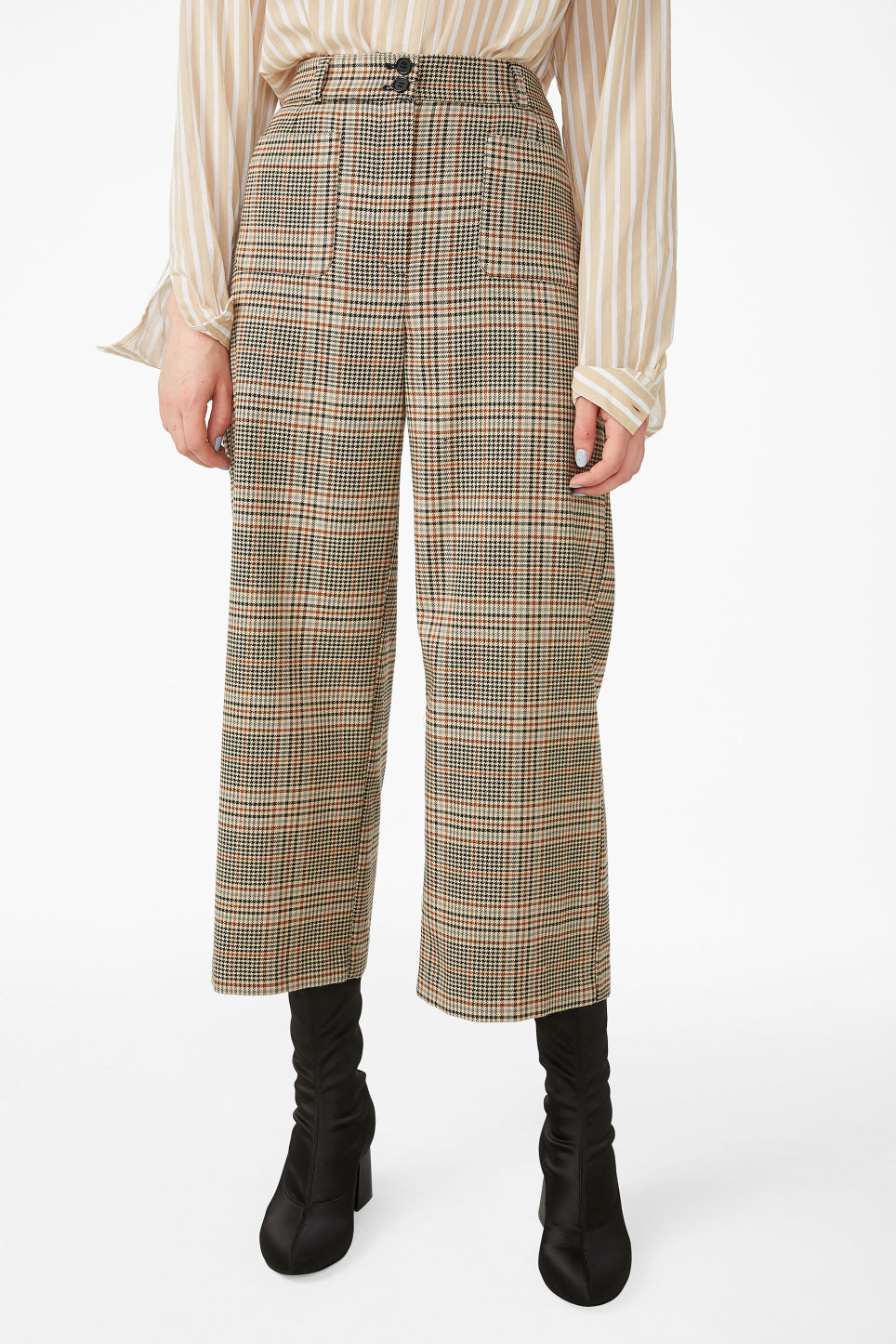 Model side image of Monki straight-leg trousers in orange