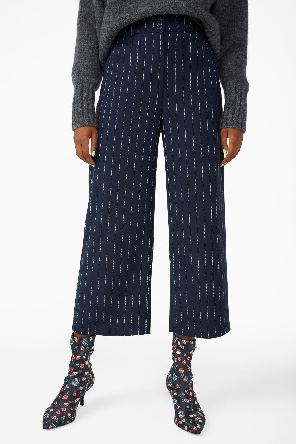 Model side image of Monki straight-leg trousers in blue