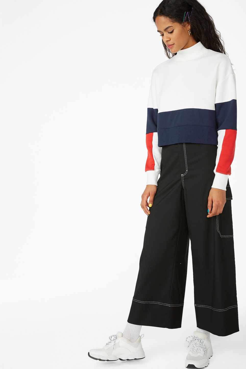 Model side image of Monki high-neck sweater in white