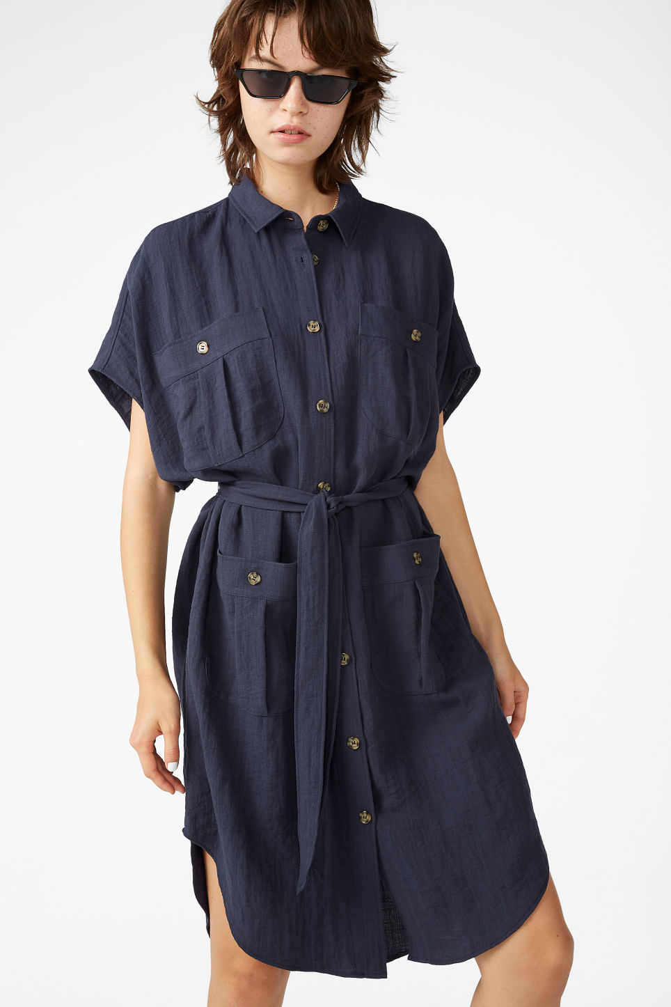Model front image of Monki buttoned pocket dress in blue