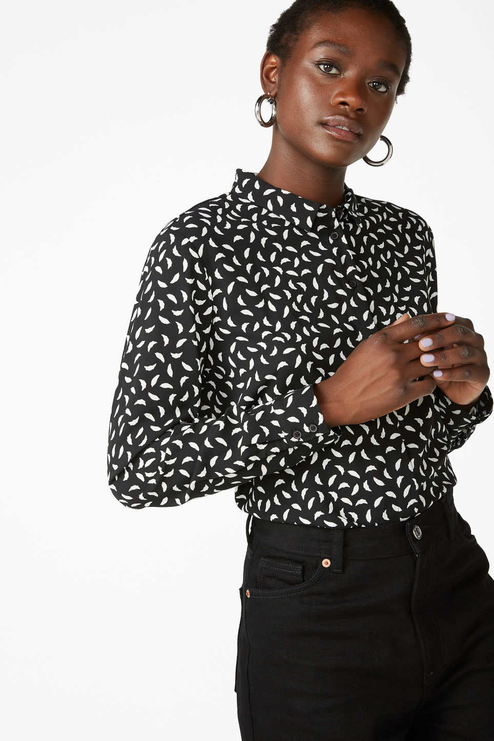 Model front image of Monki flowy pleat back blouse in black