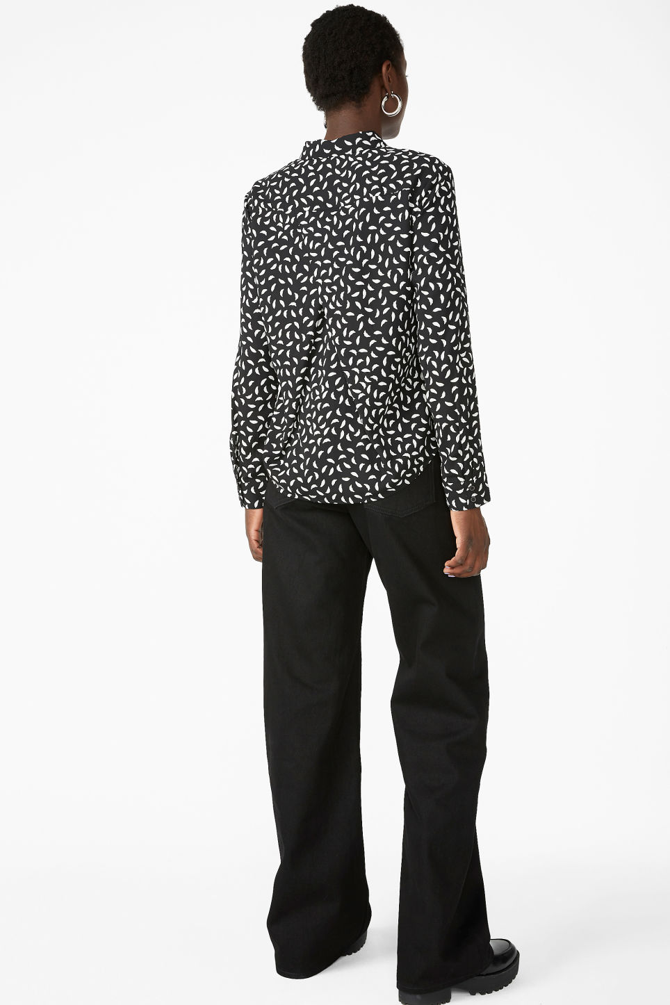 Model back image of Monki flowy pleat back blouse in black