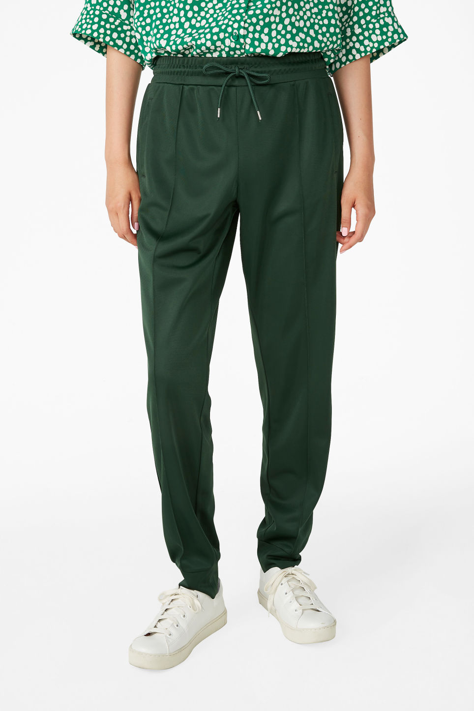 Model side image of Monki formal joggers in green