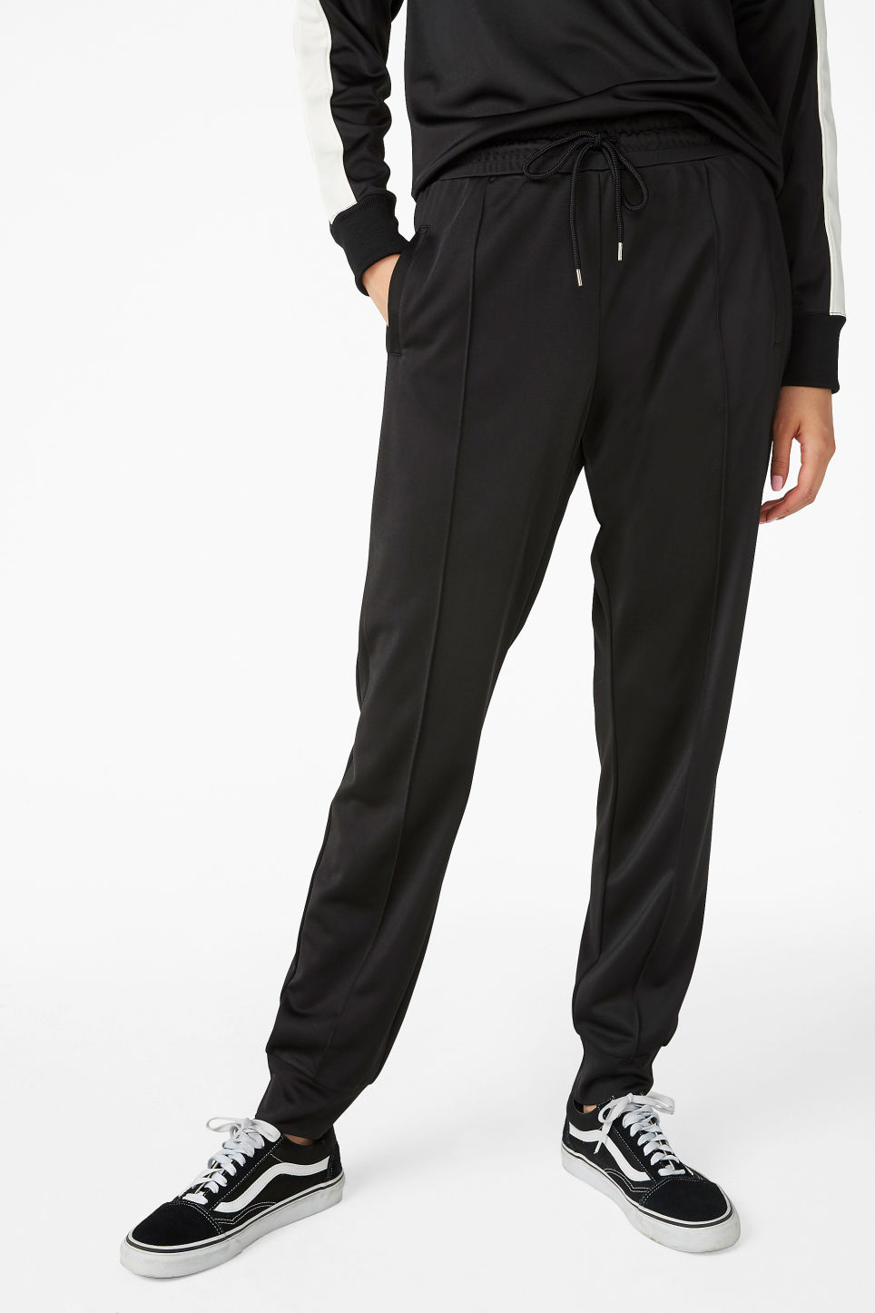 Model side image of Monki formal joggers in black