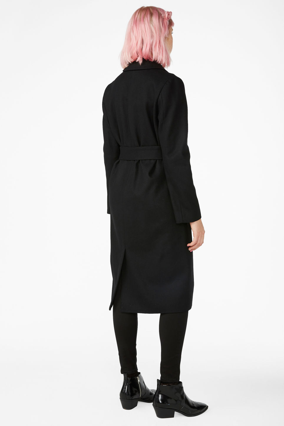 Model back image of Monki long belted coat in black