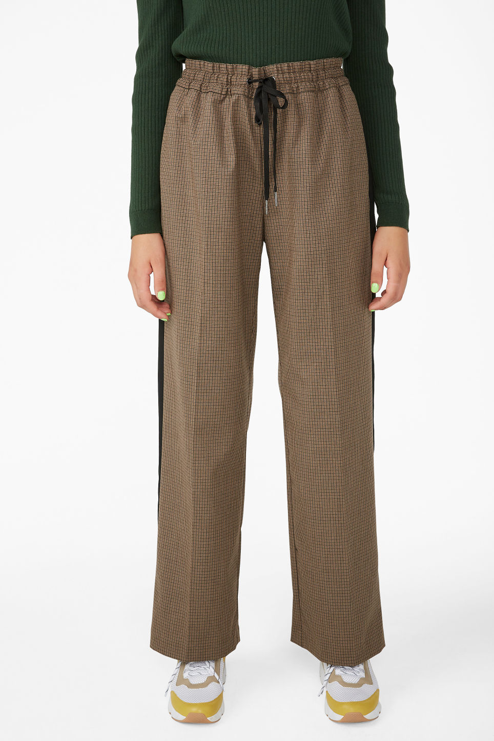 Model side image of Monki sporty trousers in beige