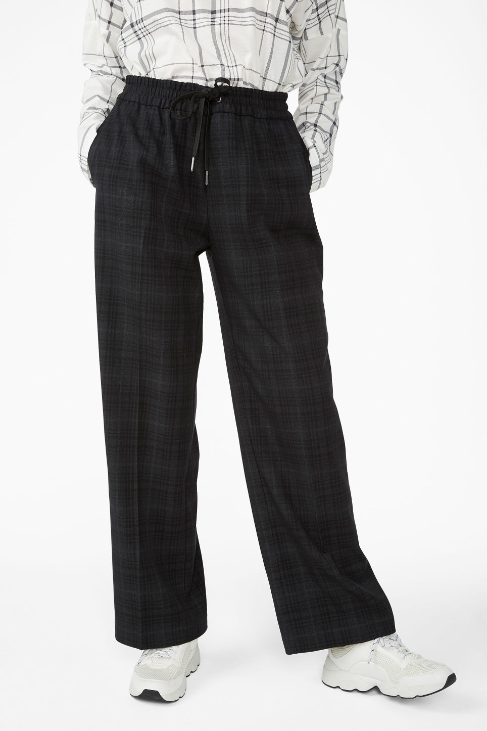 Model side image of Monki sporty trousers in black