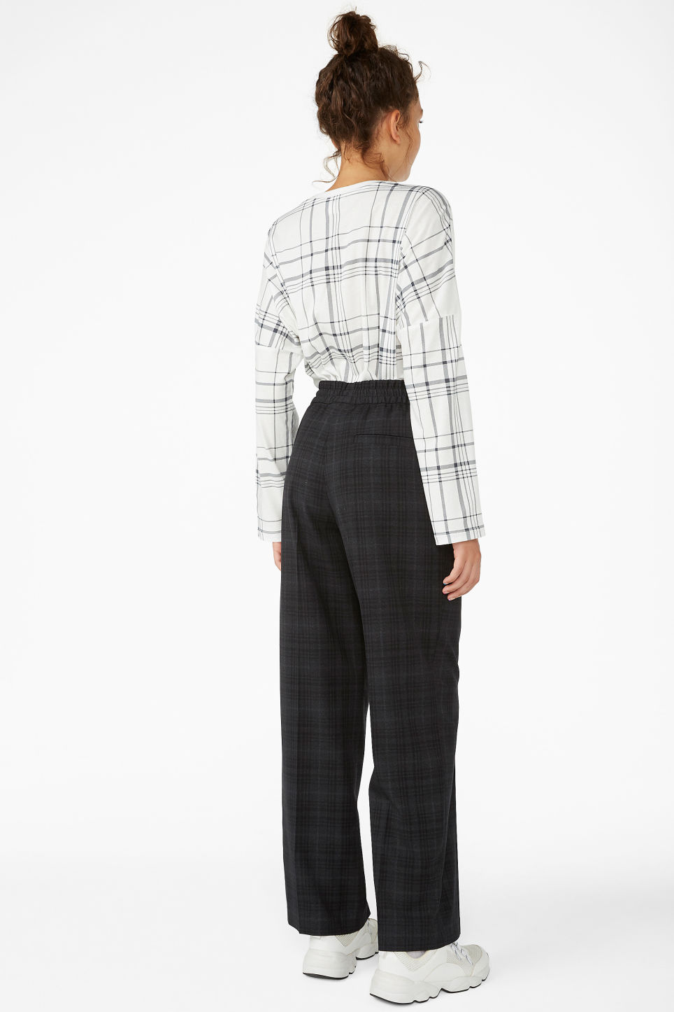 Model back image of Monki sporty trousers in black