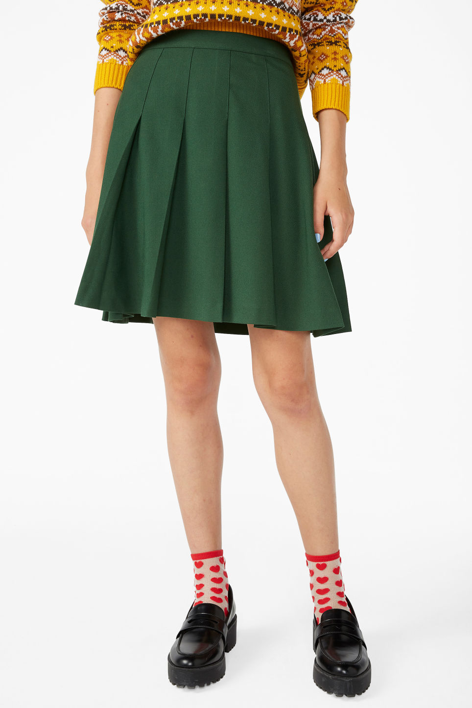 Model side image of Monki pleated skirt in green