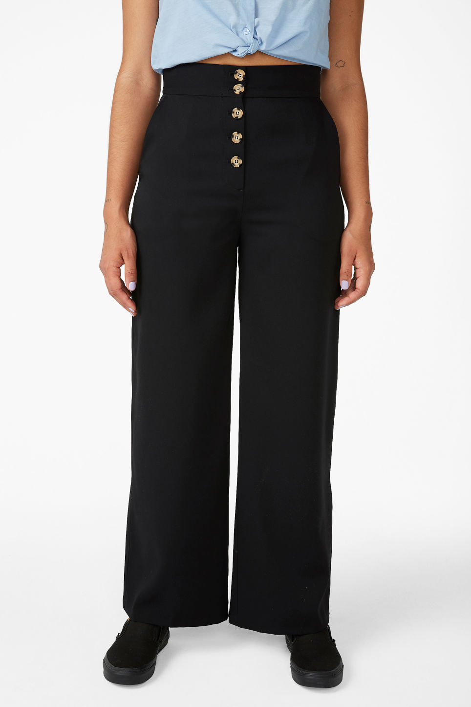 Model side image of Monki wide high-waist trousers in black
