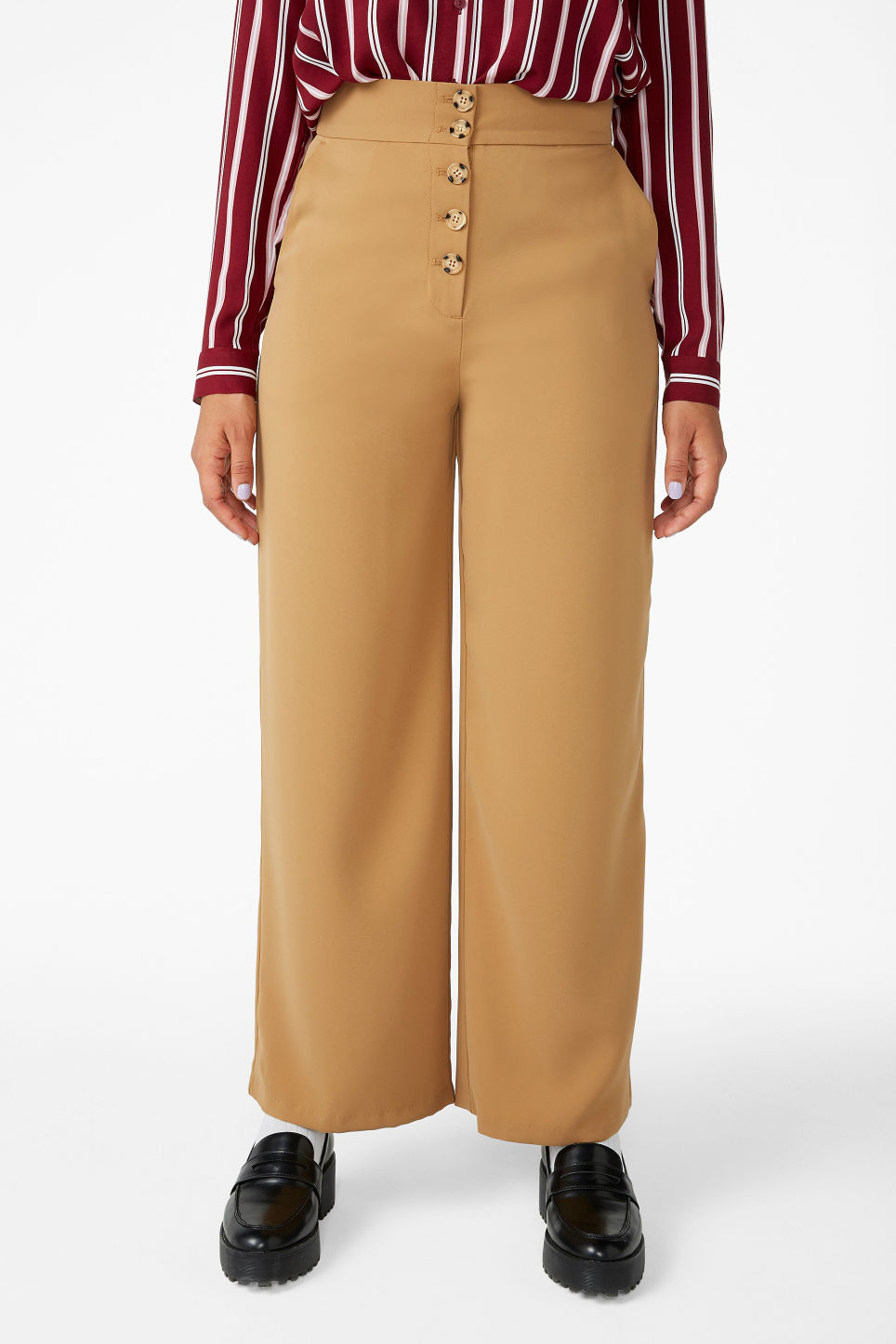 Model side image of Monki wide high-waist trousers in beige