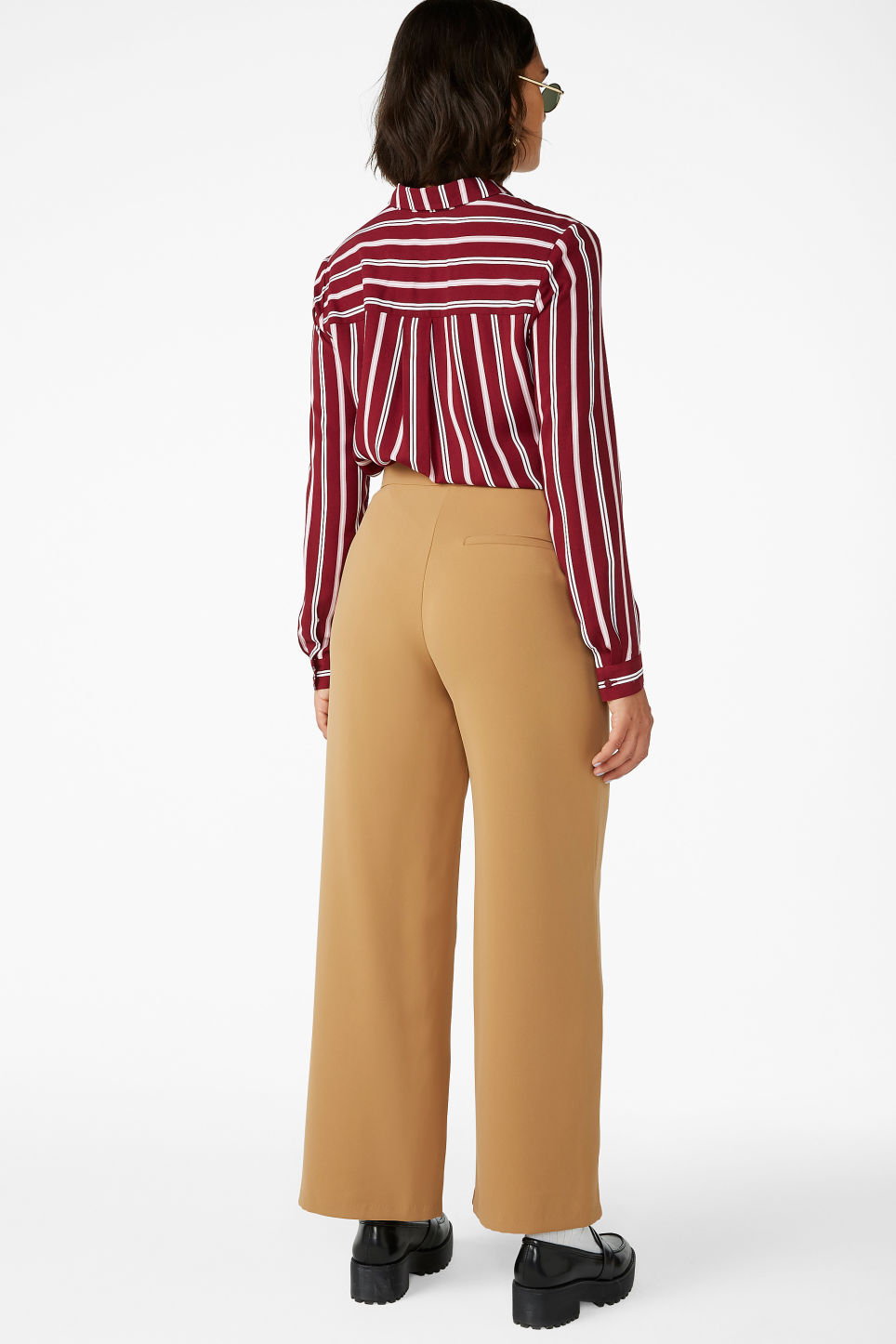Model back image of Monki wide high-waist trousers in beige