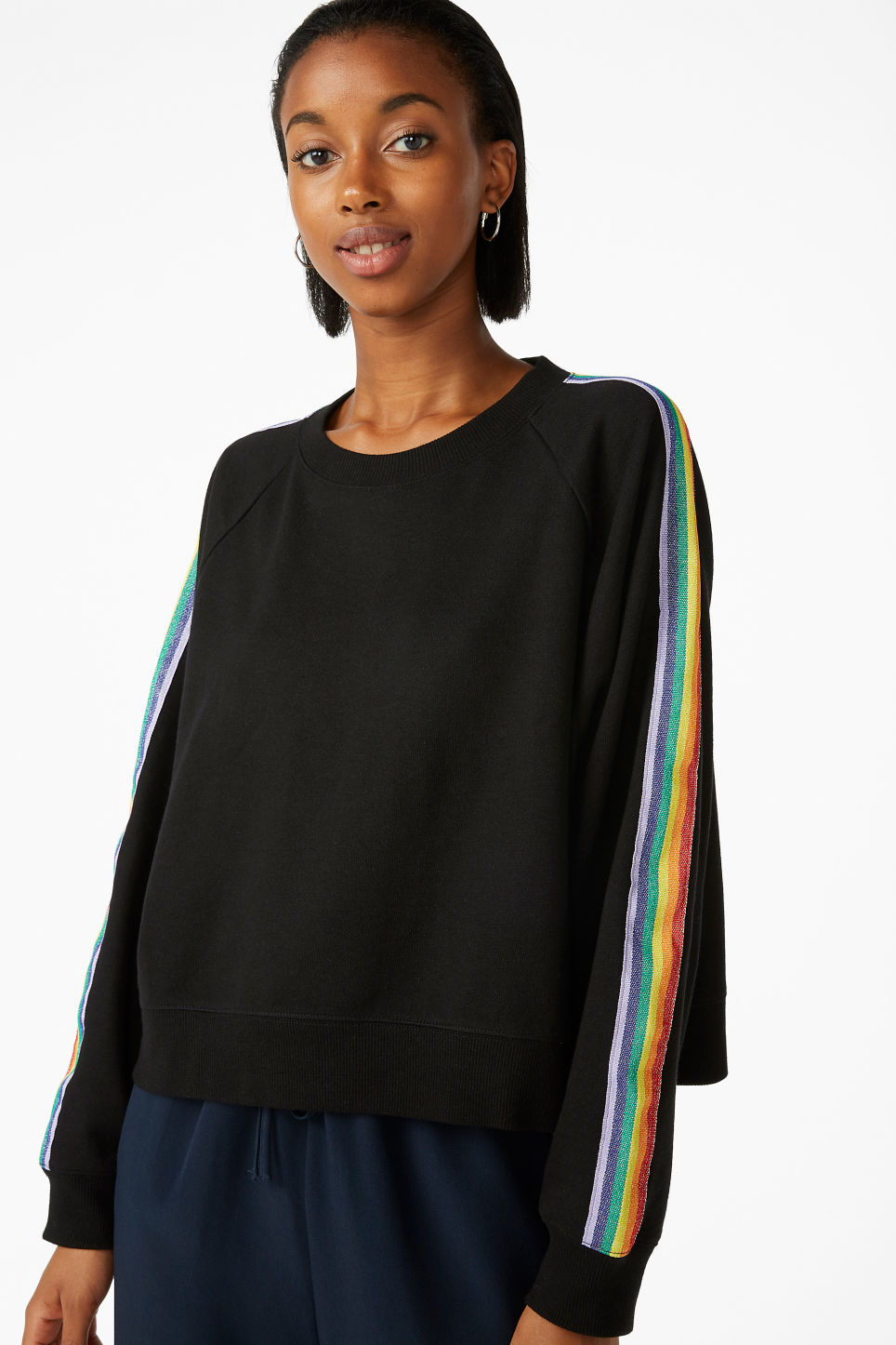 Model front image of Monki rainbow stripe sweatshirt  in black