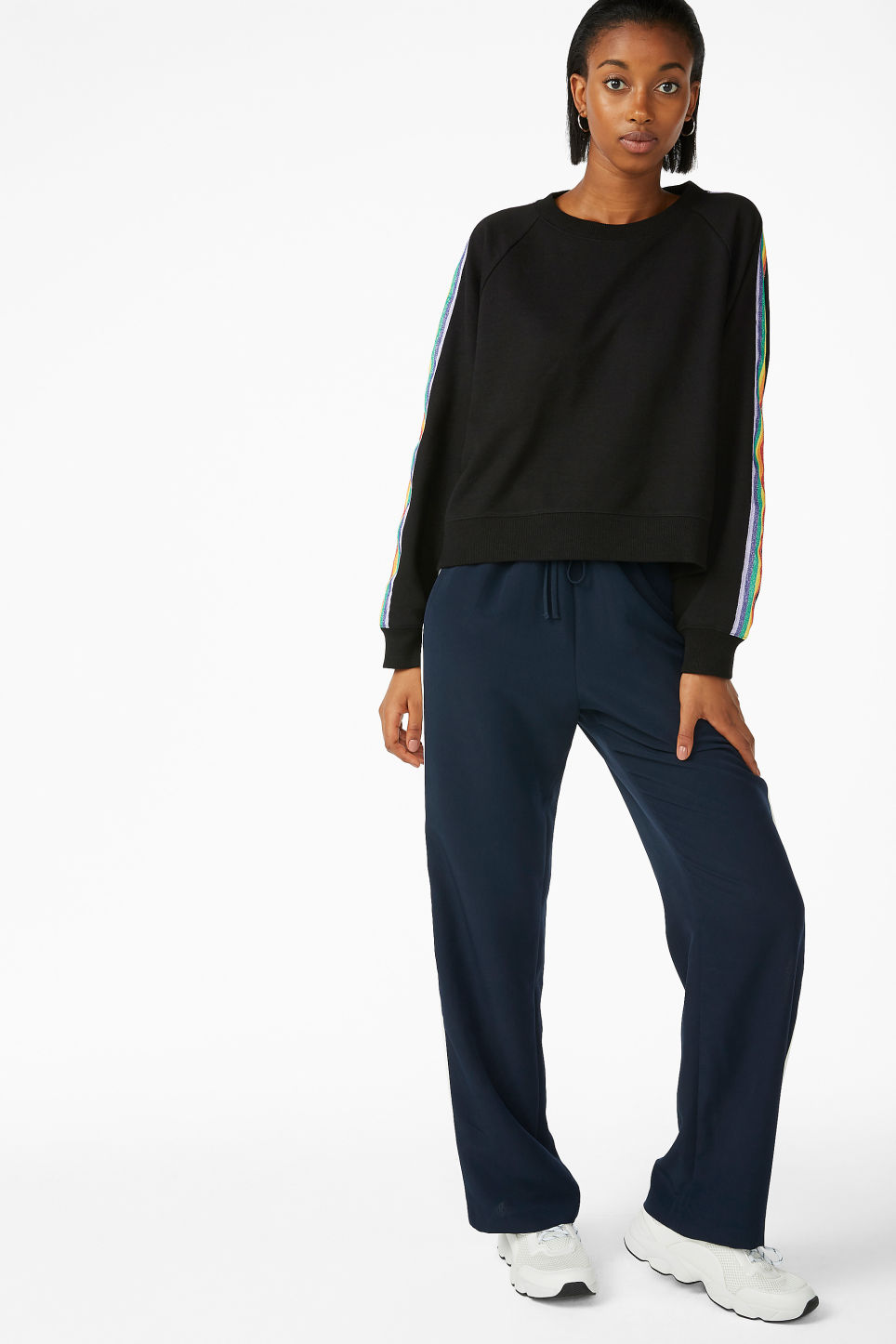 Model side image of Monki rainbow stripe sweatshirt  in black
