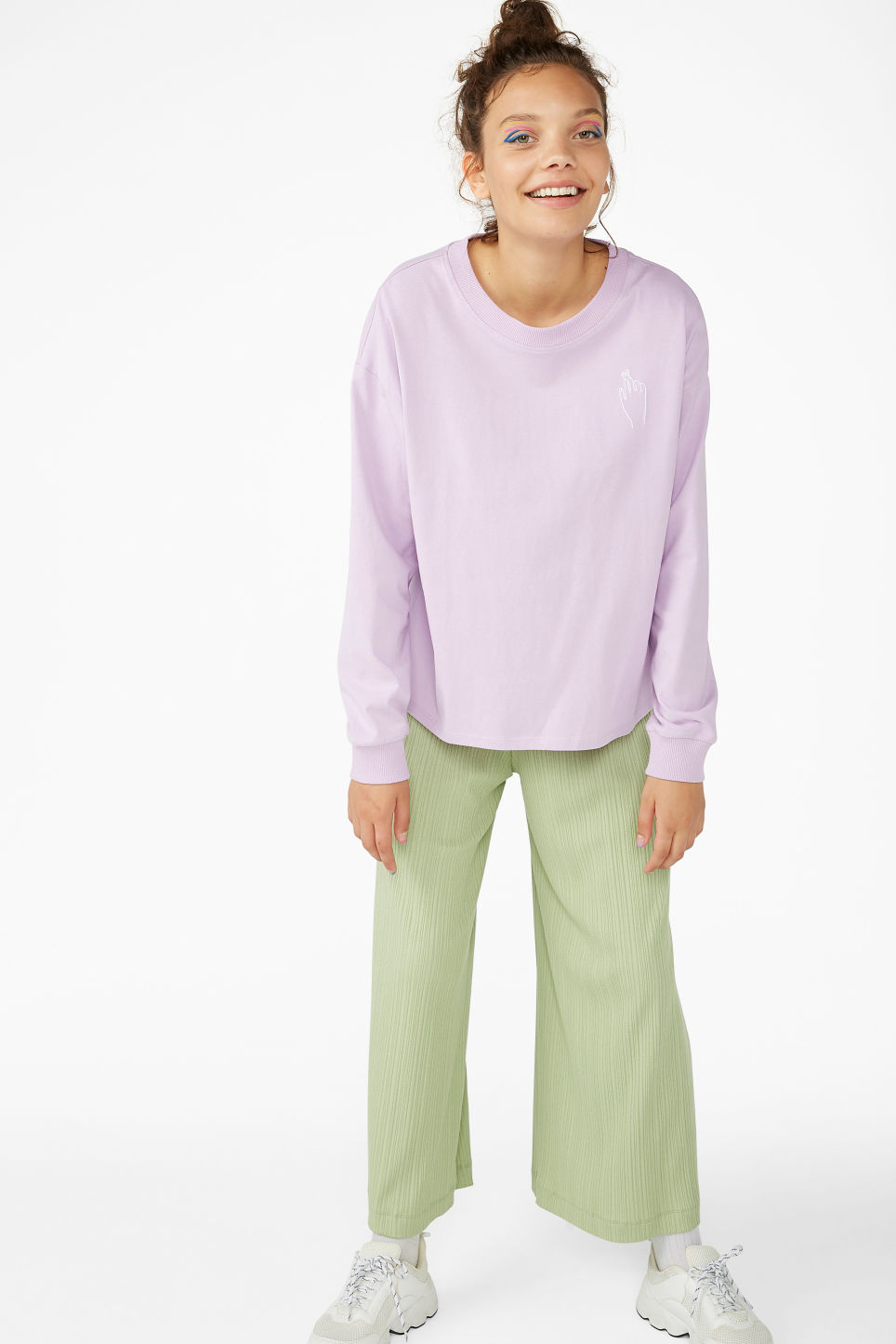 Model side image of Monki long-sleeved top in purple
