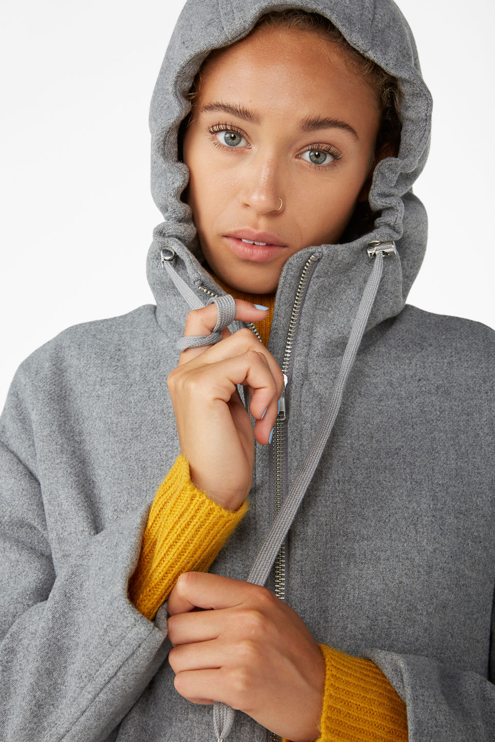 Model side image of Monki long hood jacket in grey