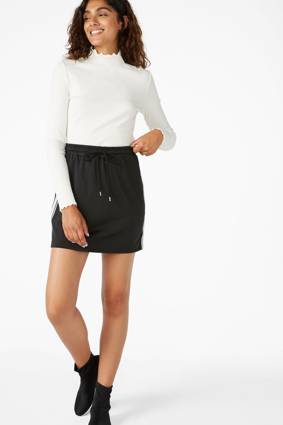 Model front image of Monki sporty drawstring skirt in black