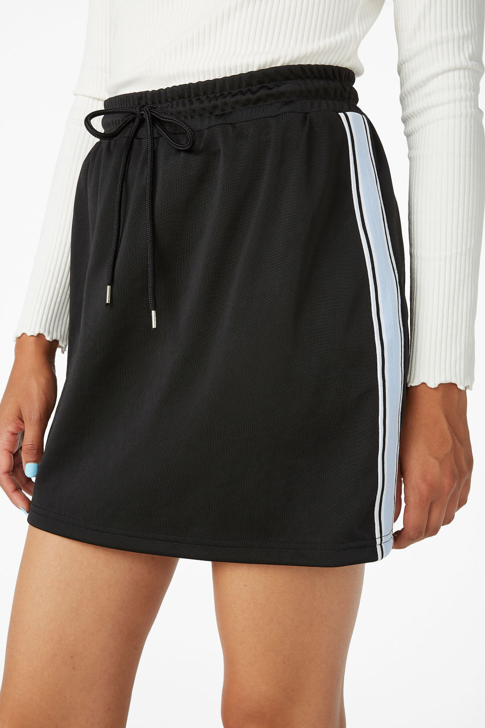 Model side image of Monki sporty drawstring skirt in black