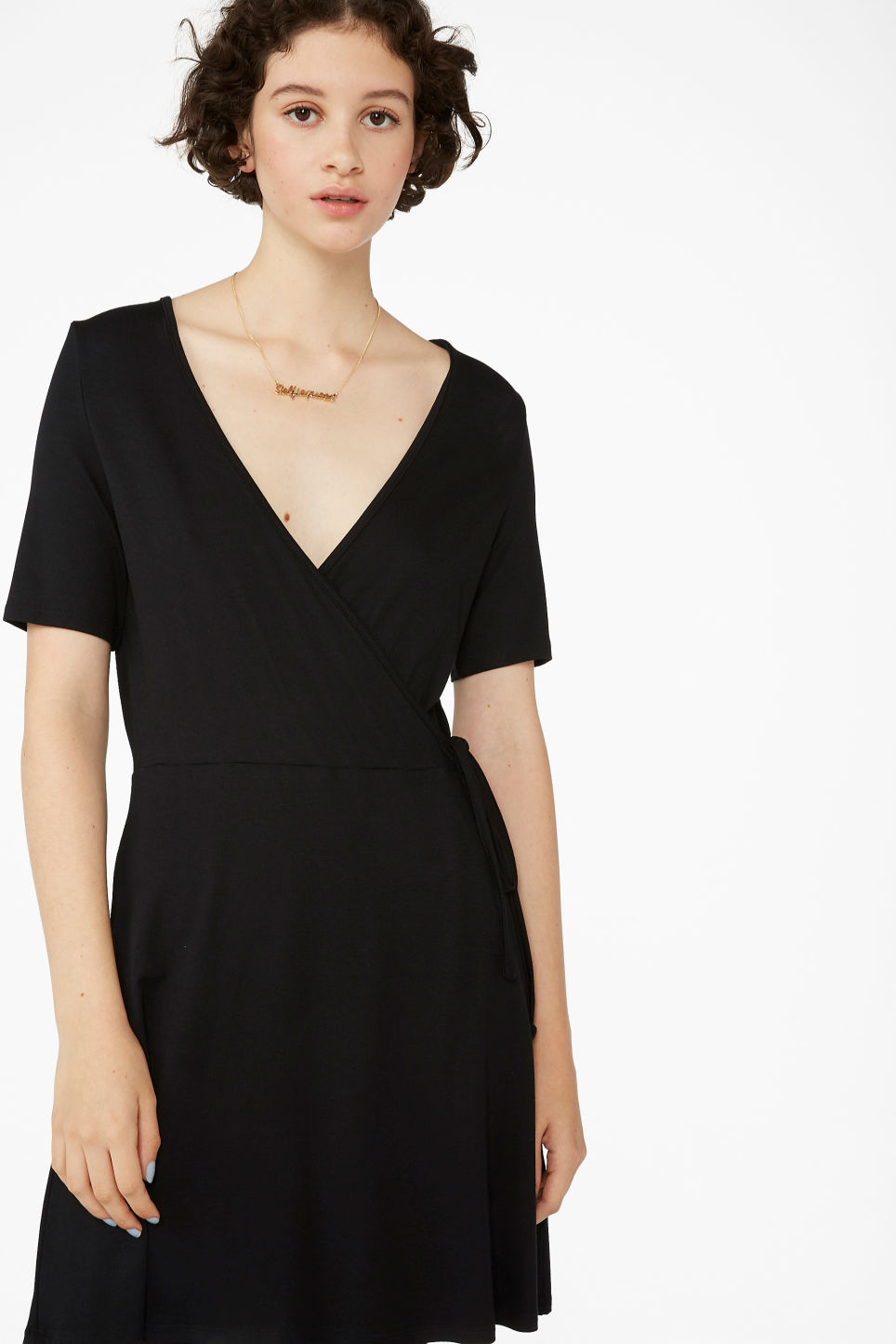 Model front image of Monki v-neck wrap dress in black