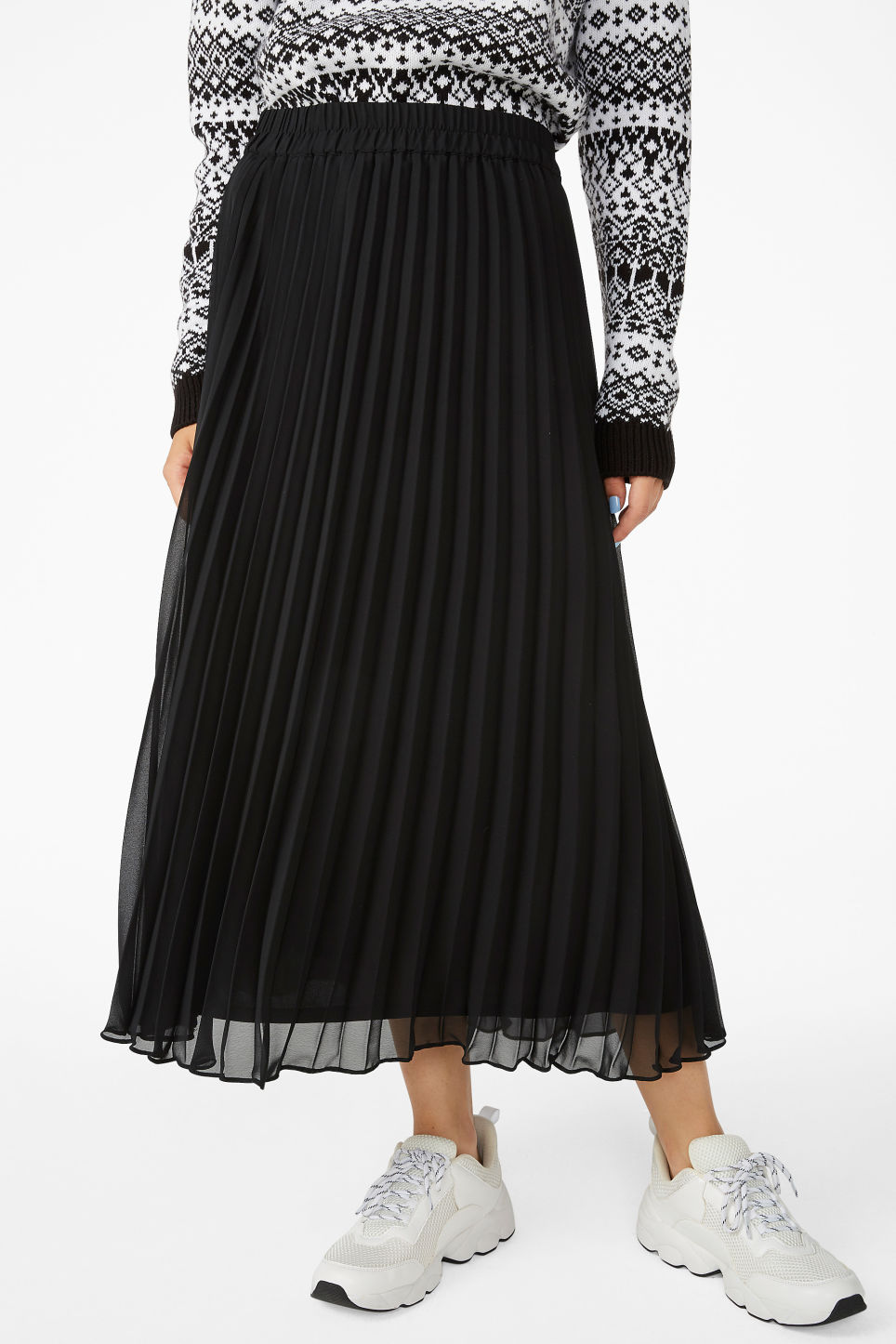 Model side image of Monki flowy midi skirt in black