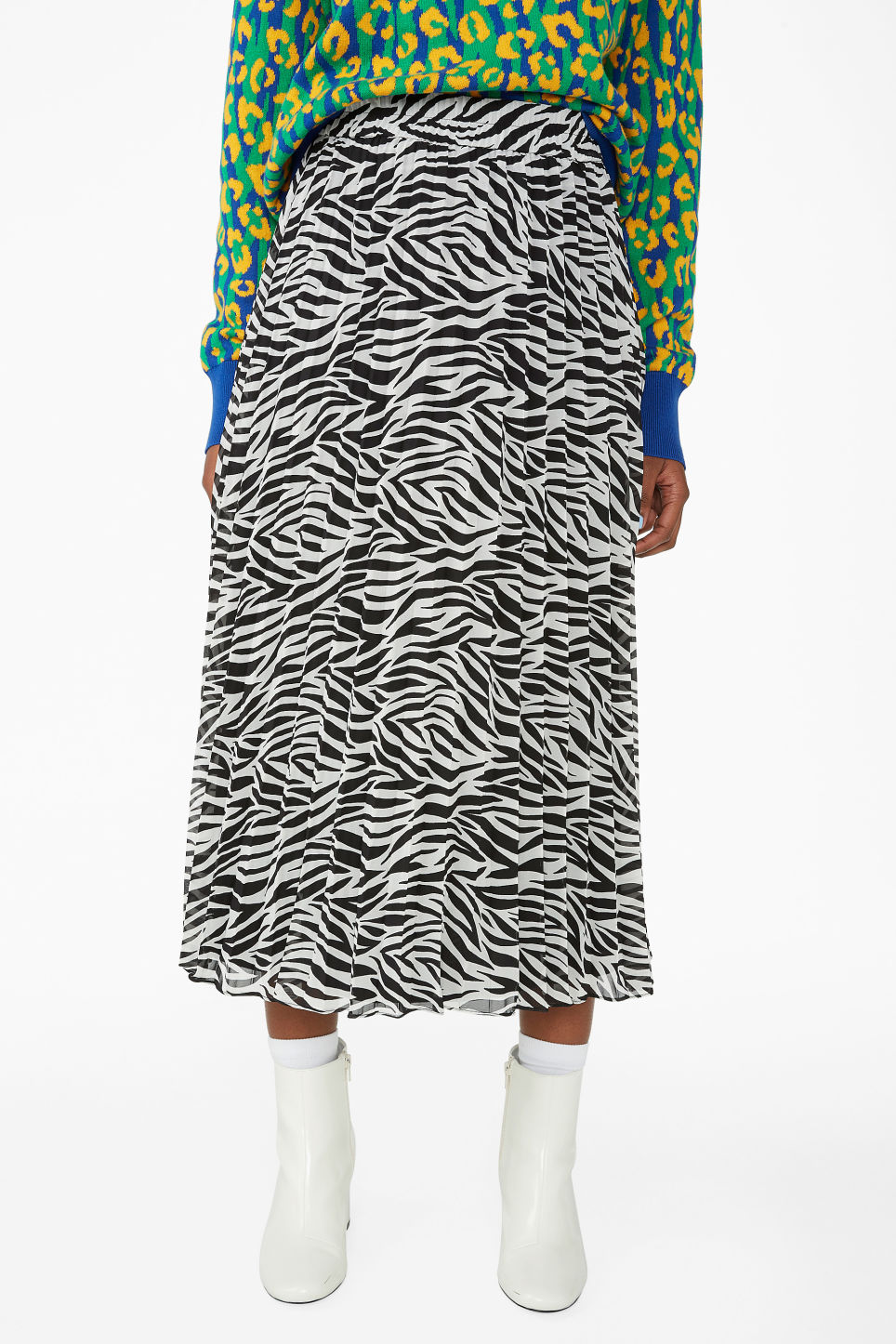 Model side image of Monki pleated midi skirt in black