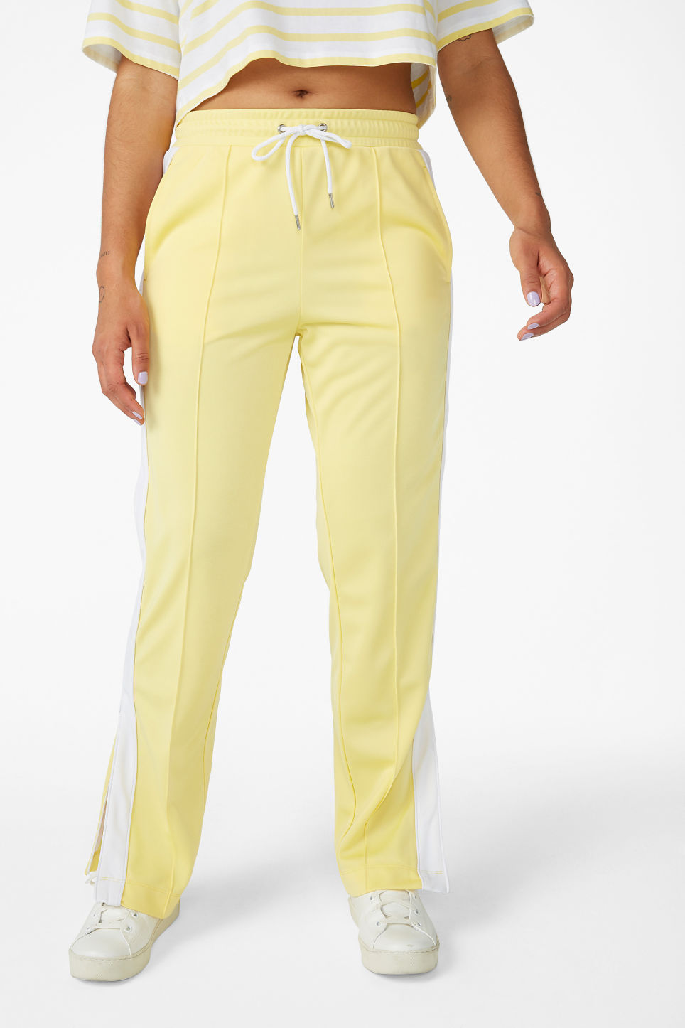 Model side image of Monki tailored track pants in yellow