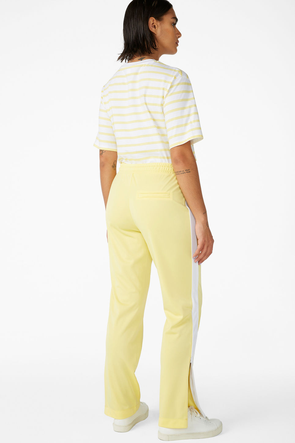 Model back image of Monki tailored track pants in yellow