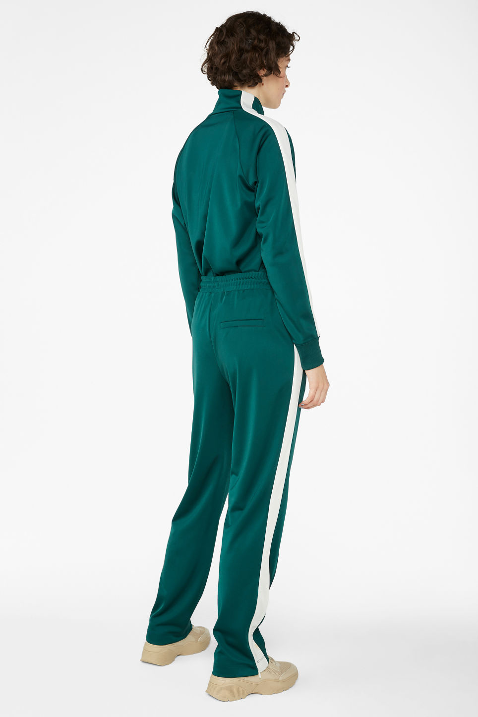 Model back image of Monki tailored track pants in green