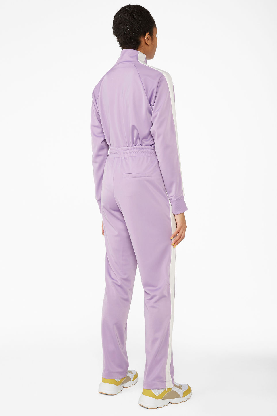 Model back image of Monki tailored track pants in purple