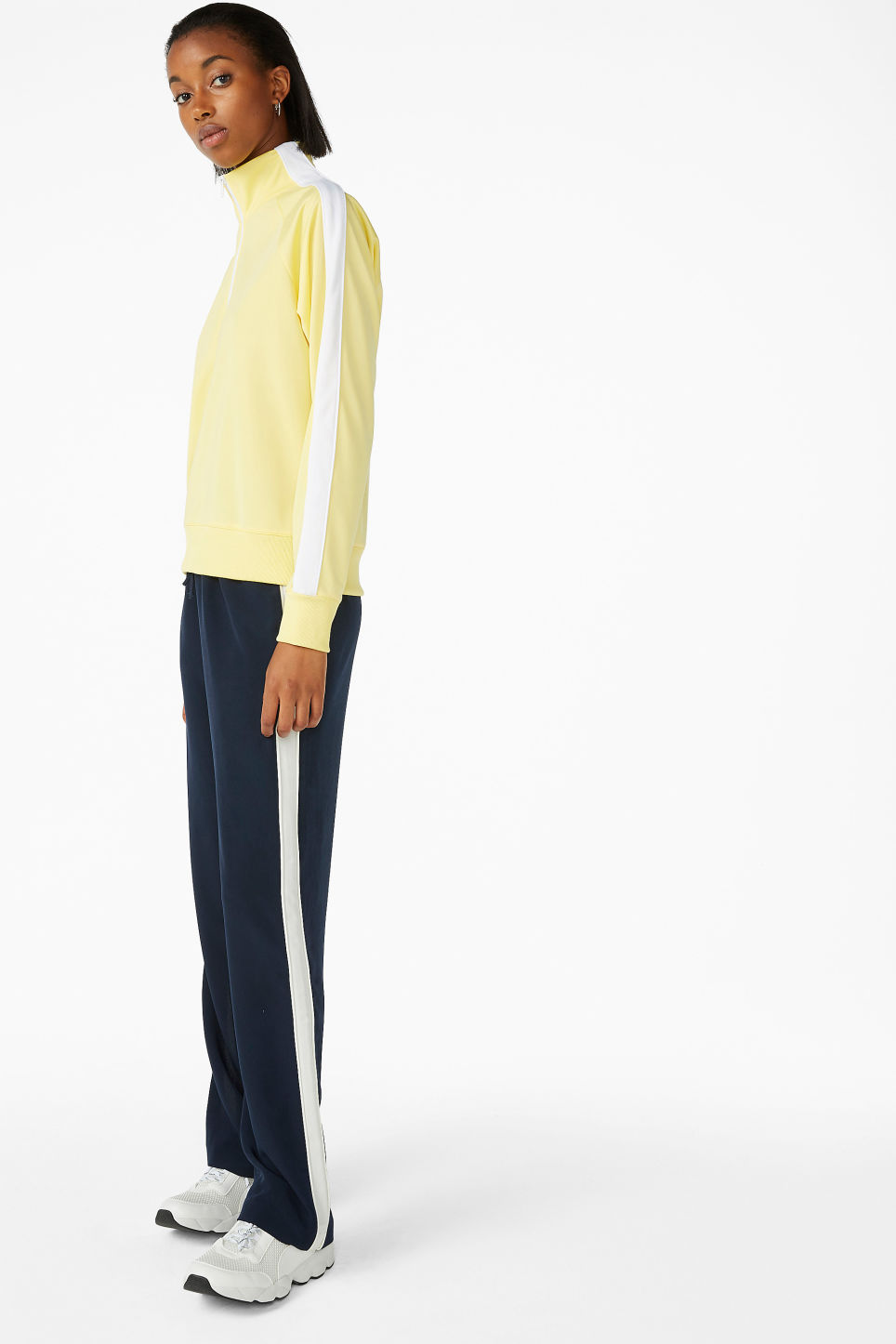 Model side image of Monki half zip tracksuit jacket  in yellow
