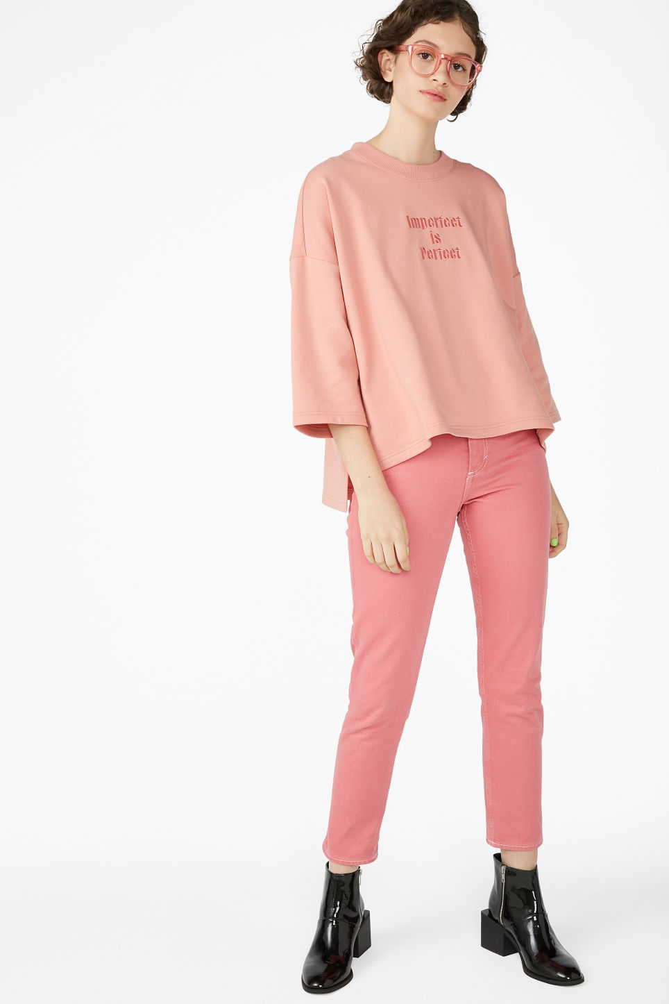 Model side image of Monki raglan sweater in pink
