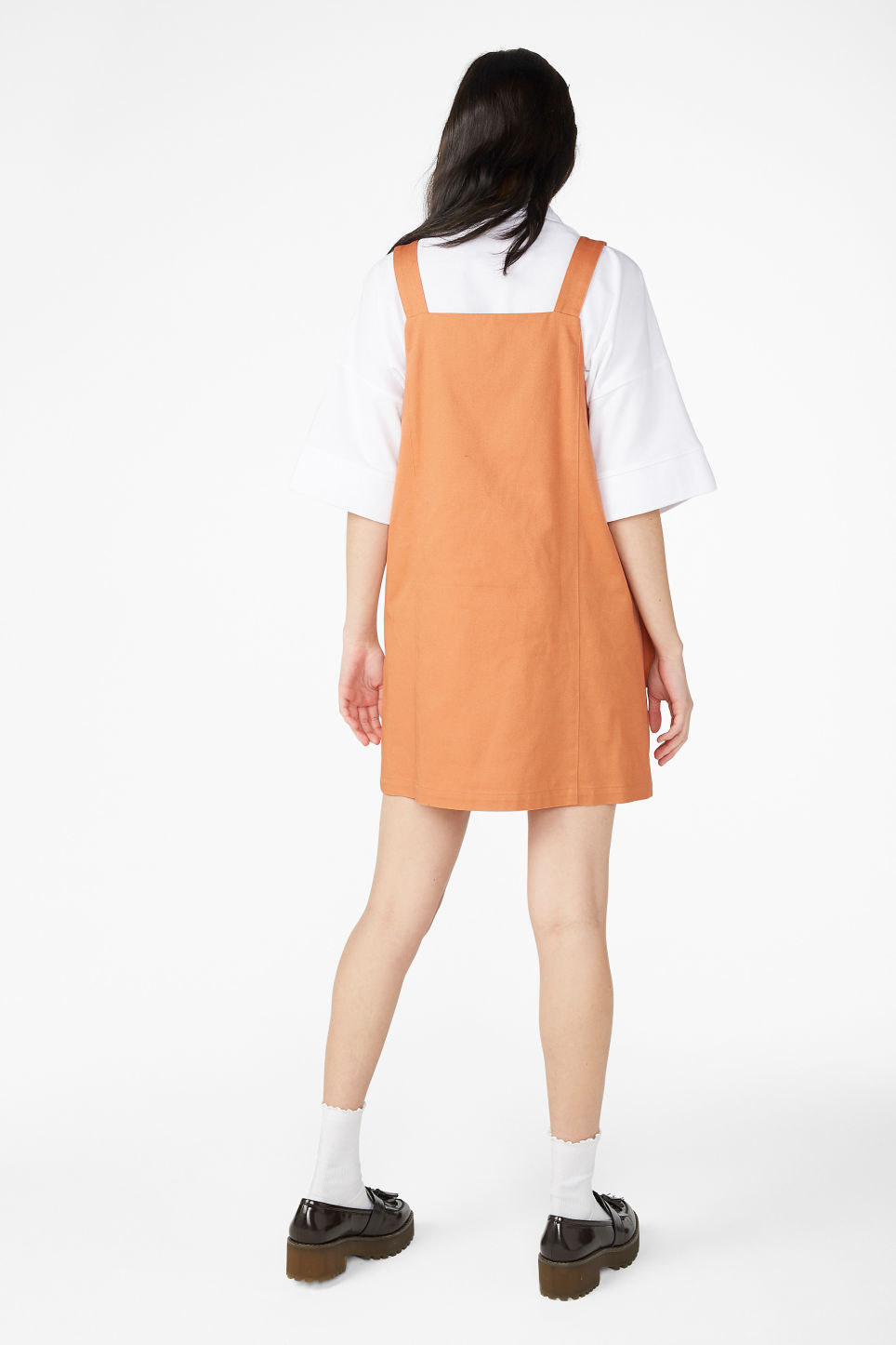 Model back image of Monki double breasted dungaree dress in orange
