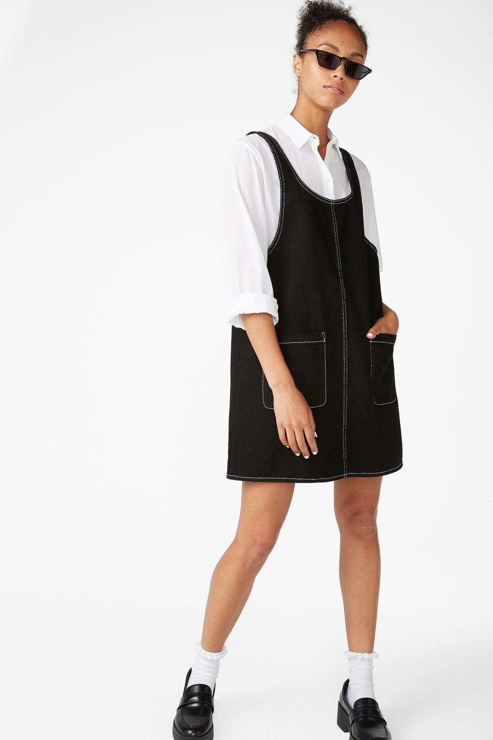 Model front image of Monki contrast stitch pinafore dress  in black