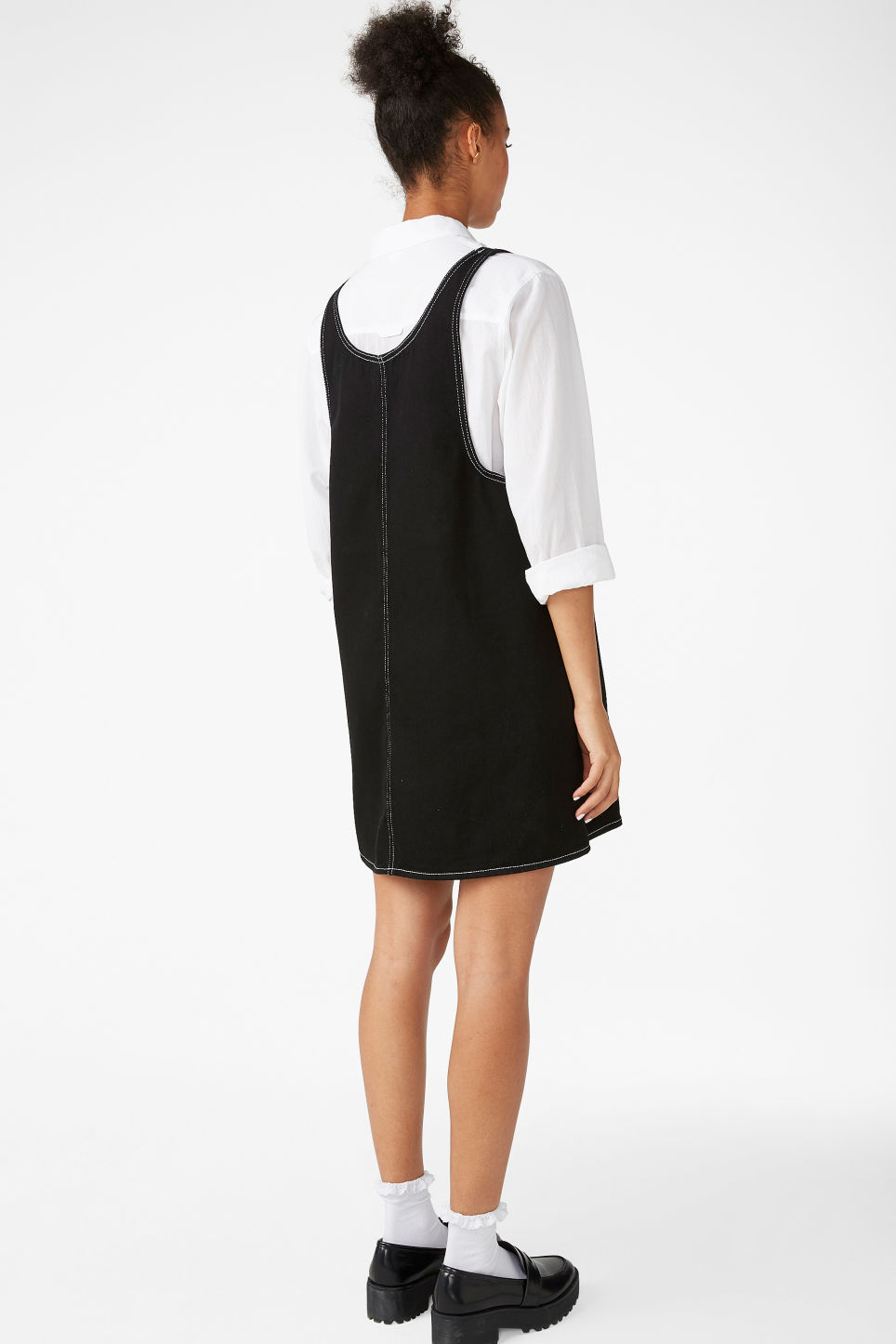 Model back image of Monki contrast stitch pinafore dress  in black