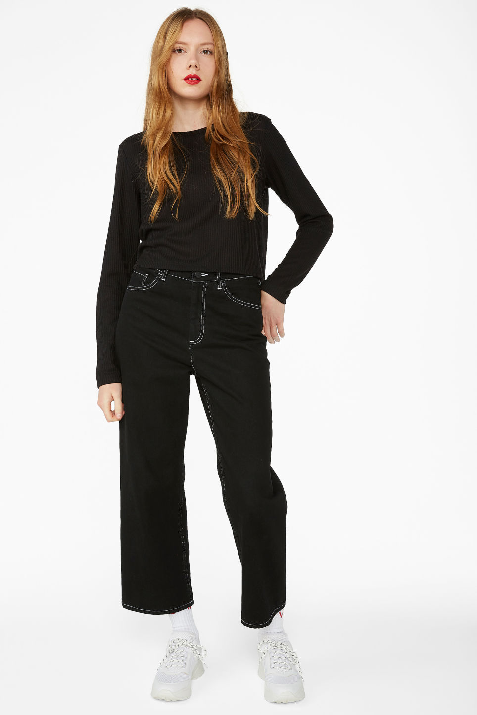 Model side image of Monki long-sleeved ribbed top in black