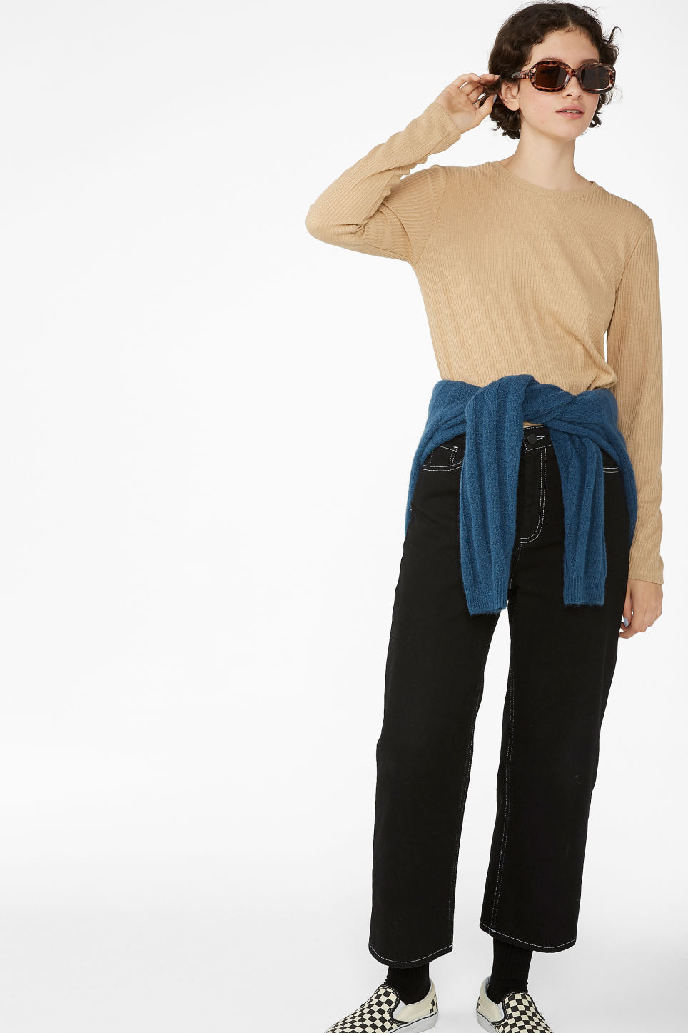 Model side image of Monki long-sleeved ribbed top in beige