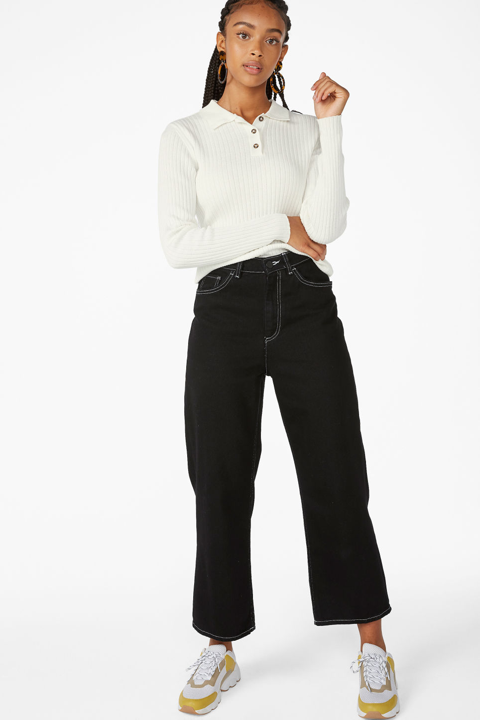 Model side image of Monki ribbed polo top in white