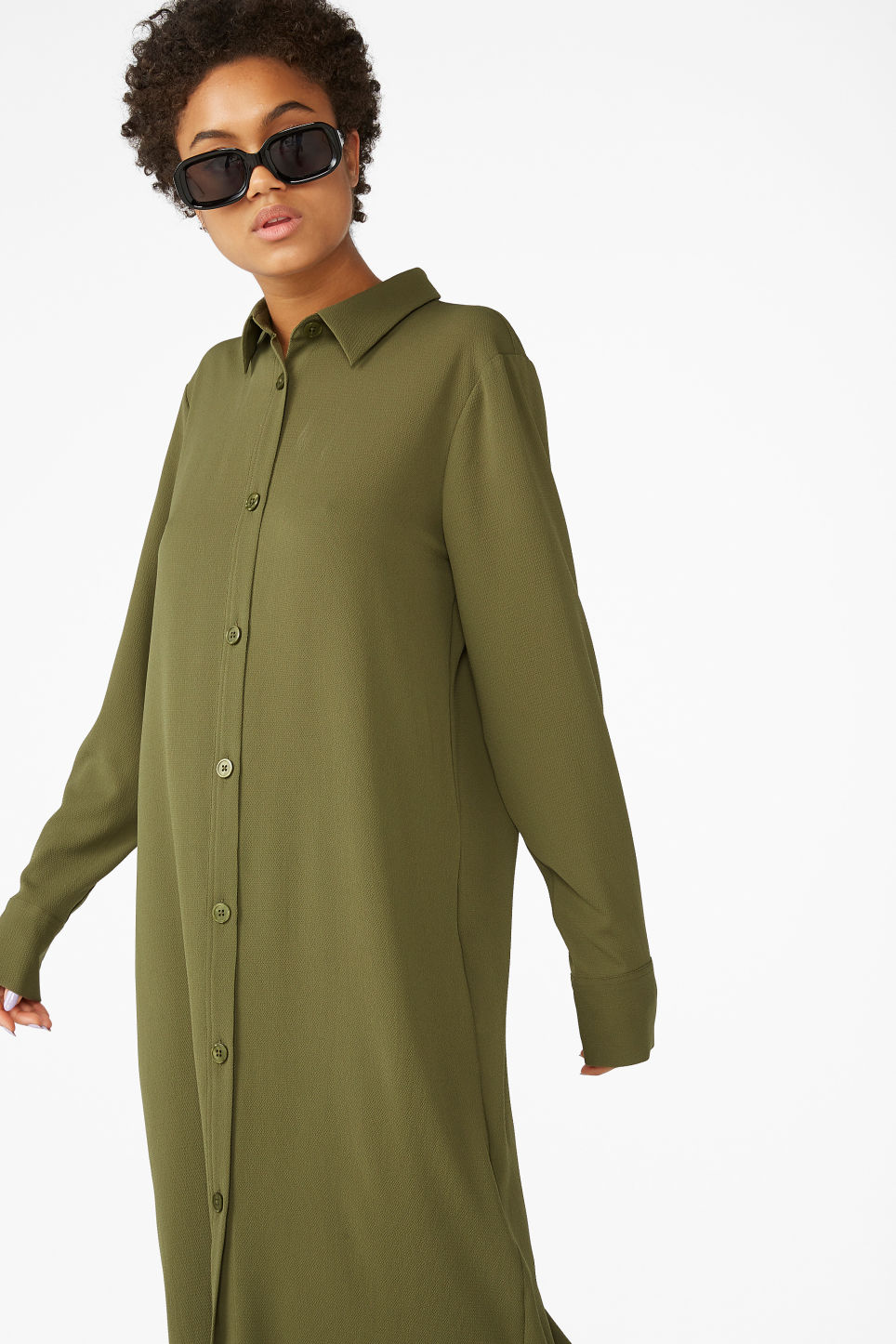 Model front image of Monki long button-up shirt dress in green